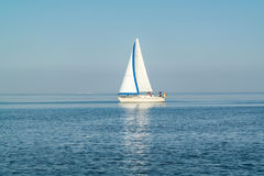 Sailboat sailing at calm and sunny Waddensea, Netherlands Stock Photography