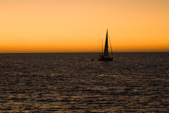 Sailboat sailing during the evening royalty free stock image