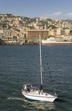 Sailboat sailing in Genoa Harbor, Genoa, Italy, Europe Royalty Free Stock Photos
