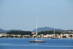 Sailboat sailing near Corfu town Royalty Free Stock Photography