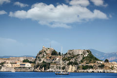 Sailboat sailing near old fortress Corfu town Royalty Free Stock Photos
