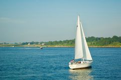 Sailboat Sailing the Ocean in Newport, Rhode Island. Sailboat sailing the ocean on a beautiful summer day in Newport, Rhode Island stock photos