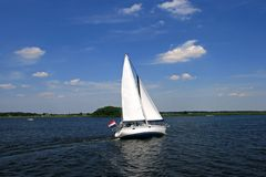 Sailboat, sailing over a river stock images