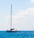 Sailboat sailing sail blue Mediterranean sea ocean horizon Stock Photos