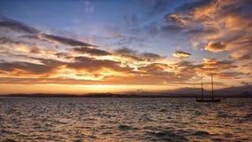 Sailboat sailing at Santander's bay by sunset. Panoramic view of sailboat sailing at Santander's bay by sunset Stock Photos