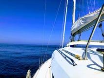 Sailboat sailing in the sea royalty free stock image