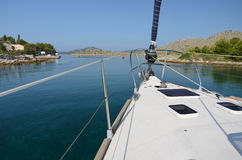 Sailboat sailing through the strait Stock Images