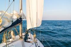 Sailboat sailing on Wadden Sea, Netherlands Stock Images