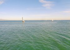 Sailboat Sailing on a Warm Spring Afternoon in Coastal California. This a an image of a sailboat gliding smoothly on the waters off the California coast in early royalty free stock photo