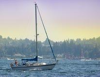 Sailboat without Sails on Lake Washington. Viewed from Medina Beach Stock Photography