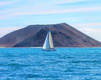 Sailboat. Saison sailing ocean vulcano water sky Stock Photo