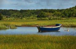 Sailboat in Salt Marsh. A sailboat rests in Salt Marsh in Harwich, Massachusetts Stock Image