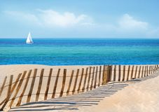 Sailboat and Sand Dune Fence Royalty Free Stock Images
