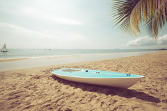 Sailboat on sand tropical beach in summer. Stock Images
