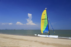 Sailboat on sandy beach Royalty Free Stock Image