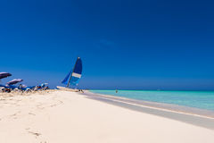 Sailboat on the sandy beach of the Playa Paradise of the island of Cayo Largo, Cuba. Copy space for text. Stock Images