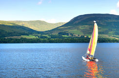 Sailboat on a Scottish loch Royalty Free Stock Photo
