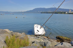 Sailboat Scuttled and on the Rocks Royalty Free Stock Photo