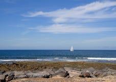 Sailboat at sea on Atlantic Ocean. Solitary sailboat at sea on Atlantic Ocean Stock Photos