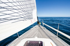 Sailboat at sea. The bow of a sailboat at sea on a clear sunny day Royalty Free Stock Images