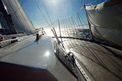Sailboat at sea and droplets of water. The bow of a sailboat at sea, facing sun, with droplets of water Stock Image