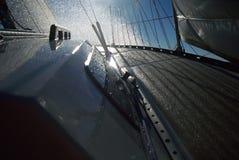 Sailboat at sea and droplets of water. The bow of a sailboat at sea, facing sun, with droplets of water Royalty Free Stock Photo