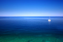 Sailboat on the sea. On horizon Stock Image