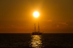 Sailboat at sea with sunset Stock Photography