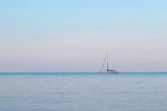 Sailboat on the sea. In twilight Stock Photos