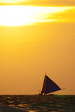 Sailboat on the sea under  sunset Royalty Free Stock Image