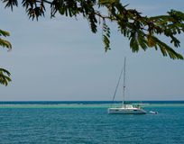 Sailboat Serenity at a Caribbean Reef Royalty Free Stock Images