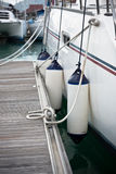 Sailboat Side Fenders CloseUp. Boat protection. Vertical shot Royalty Free Stock Images