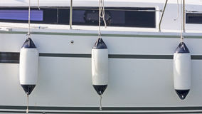 Sailboat side with fenders. Fiberglass Sailboat side with fenders Stock Photo