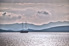 Sailboat silhouette in the sunset, Greek coast Stock Images