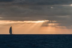 Sailboat in sunset stock images