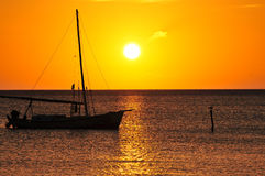 Sailboat silhouetted at sunset Royalty Free Stock Photos