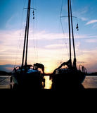 Sailboat Silhouettes. Silhouette of two Sailboats at beach against beautiful sunset stock photography