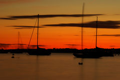 Sailboat Silhouettes at Sunset. A picturesque background with silhouettes of sailboats at sunset in the Narraganset Bay in Newport, Rhode Island Royalty Free Stock Photos