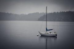 Sailboat. A sailboat sits at anchor in the bay Stock Image