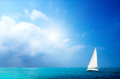 Sailboat sky and ocean Stock Images