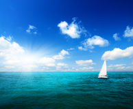 Sailboat sky and ocean Stock Image