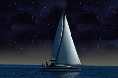 A sailboat in the starry night. A sailboat sails under the starry sky royalty free stock images