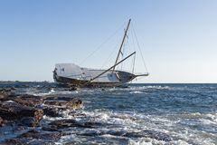 Sailing ship stranded on the rocks Royalty Free Stock Photo