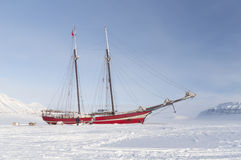 Sailboat stranded on sea ice - Horizontal. Sailboat aground in the frozen sea on the Svalbard island, in Norway's Arctic Stock Photography