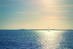 Sailboat in sunlight Stock Photos