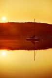 Sailboat at sunrise Stock Photos