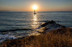 Sailboat at sunrise Royalty Free Stock Images