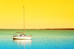 Sailboat in sunrise Royalty Free Stock Photo