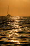 Sailboat at sunrise Royalty Free Stock Photo