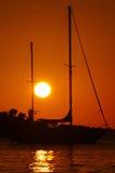 Sailboat with sunset Stock Photos